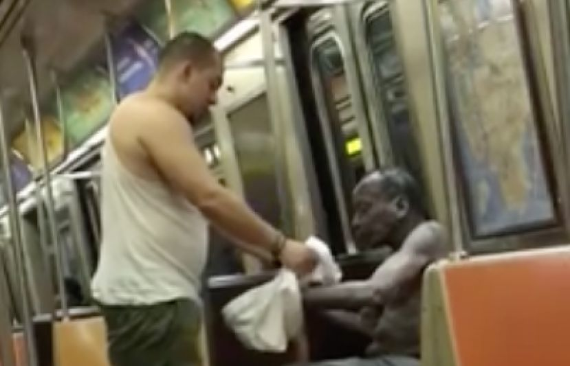 Guy sacrificed the clothes off his back to keep a homeless man from getting cold on the subway!